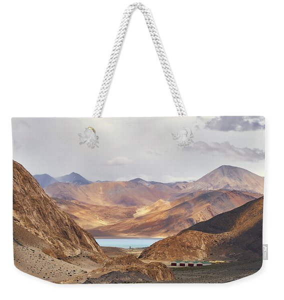 Weekender Tote Bag featuring the photograph First Glimpse by Whitney Goodey