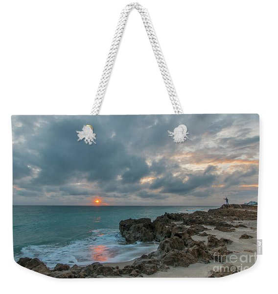 Weekender Tote Bag featuring the photograph Fisherman On Rocks by Tom Claud