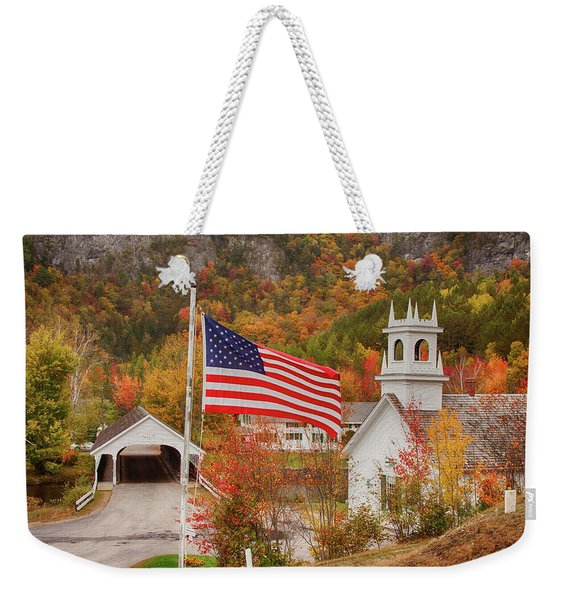 Weekender Tote Bag featuring the photograph Flag Flying Over The Stark Covered Bridge by Jeff Folger