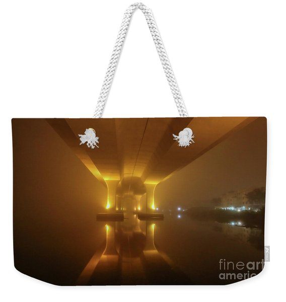 Weekender Tote Bag featuring the photograph Foggy Bridge Glow by Tom Claud