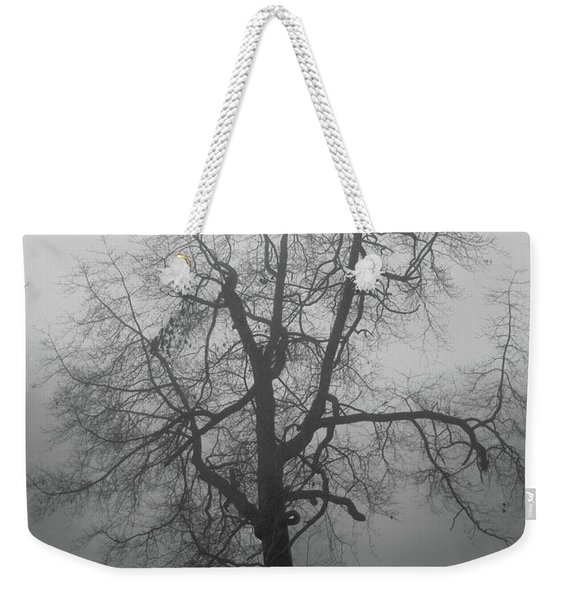 Weekender Tote Bag featuring the photograph Foggy Tree In Black And White by William Selander