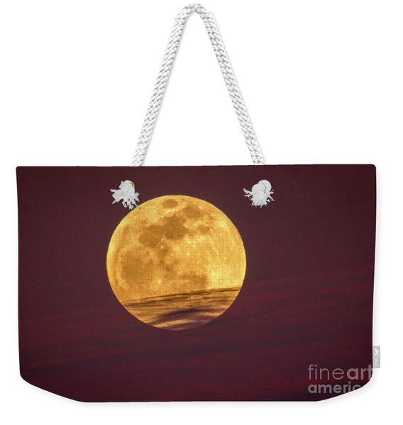 Weekender Tote Bag featuring the photograph Full Moon Above Clouds by Tom Claud
