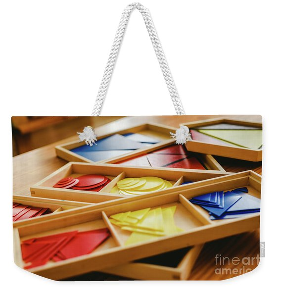 Geometric Material In Montessori Classroom For The Learning Of Children In Mathematics Area. Weekender Tote Bag