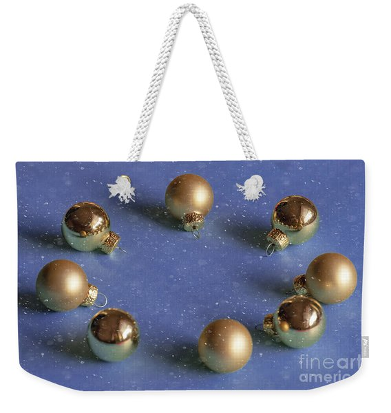 Golden Christmas Balls On The Snowy Background Weekender Tote Bag