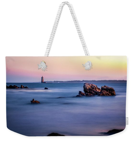 Weekender Tote Bag featuring the photograph Harbor Light by Jeff Sinon