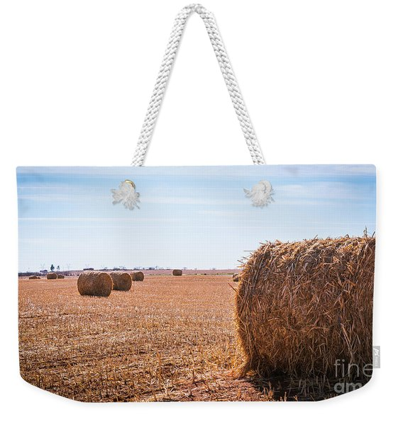 Weekender Tote Bag featuring the photograph Hay Rolls by Dheeraj Mutha