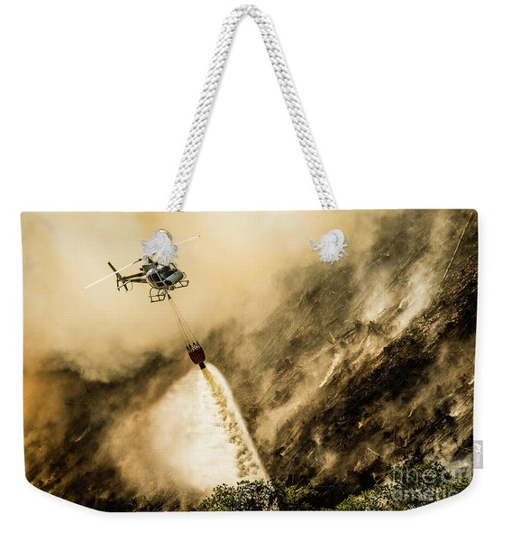 Helicopter Dropping Water On A Forest Fire Weekender Tote Bag