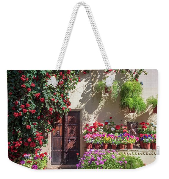 Weekender Tote Bag featuring the photograph In The Garden by Robin Zygelman