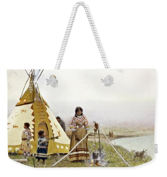 Indian Woman Standing At Cooking Tripod Near Water With Two Young Indian Girls At Her Left By Walter Weekender Tote Bag