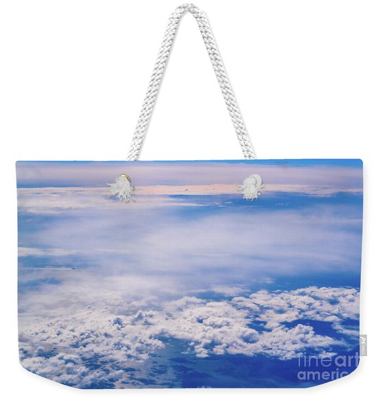 Intense Blue Sky With White Clouds And Plane Crossing It, Seen From Above In Another Plane. Weekender Tote Bag