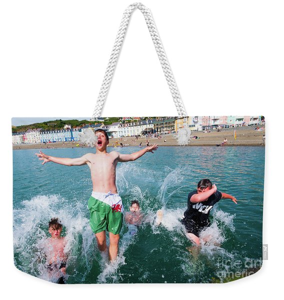 Jetty Jumping Into The Sea Weekender Tote Bag