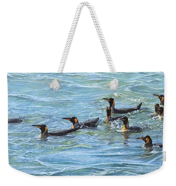Weekender Tote Bag featuring the painting King Penguins Swimming by Alan M Hunt