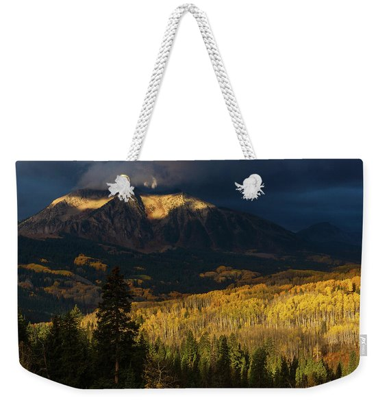 Weekender Tote Bag featuring the photograph Kiss Of Sunlight by John De Bord