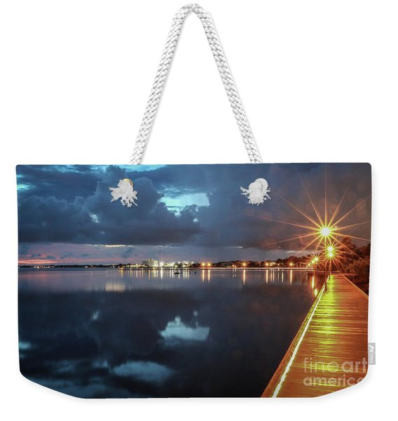 Weekender Tote Bag featuring the photograph Lamp Post Starbursts by Tom Claud