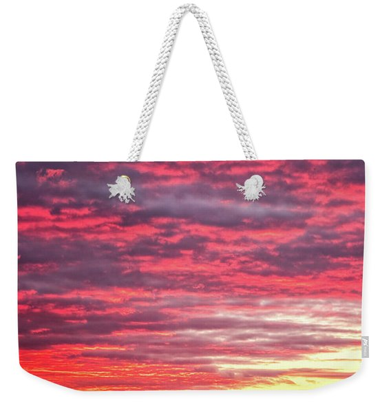 Weekender Tote Bag featuring the photograph Let There Be Light by Jeff Sinon