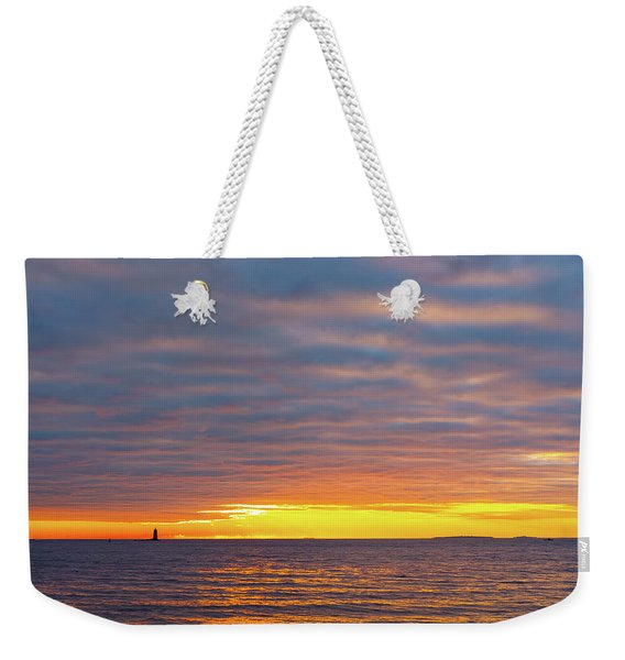 Weekender Tote Bag featuring the photograph Light On The Horizon by Jeff Sinon