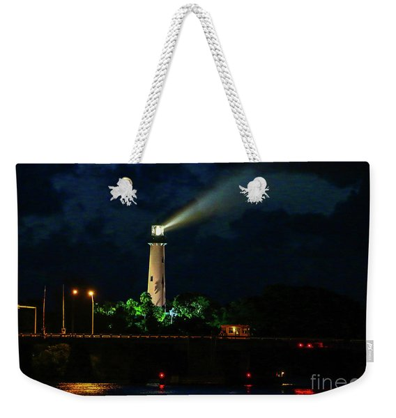 Weekender Tote Bag featuring the photograph Lighthouse Lightbeam by Tom Claud