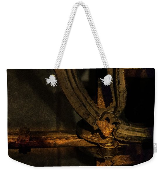 Weekender Tote Bag featuring the photograph Mechanism by Juan Contreras