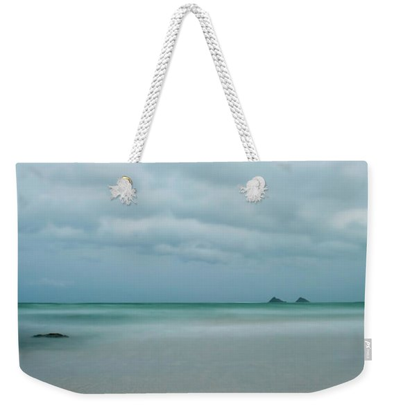 Weekender Tote Bag featuring the photograph Mokes From Kailua Beach by Charmian Vistaunet