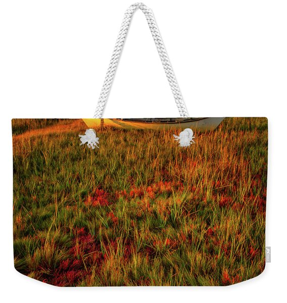 Weekender Tote Bag featuring the photograph Morning Dory by Jeff Sinon