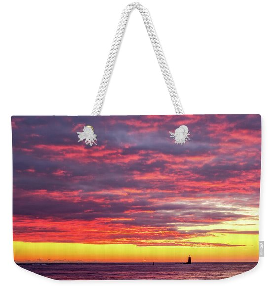 Weekender Tote Bag featuring the photograph Morning Fire Over Whaleback Light by Jeff Sinon