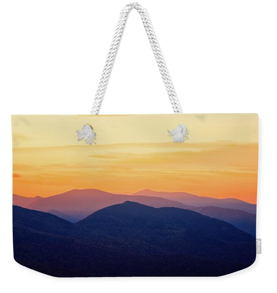 Weekender Tote Bag featuring the photograph Mountain Light And Silhouette  by Jeff Sinon