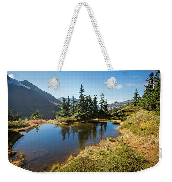 Weekender Tote Bag featuring the photograph Mountain Pond by Tim Newton