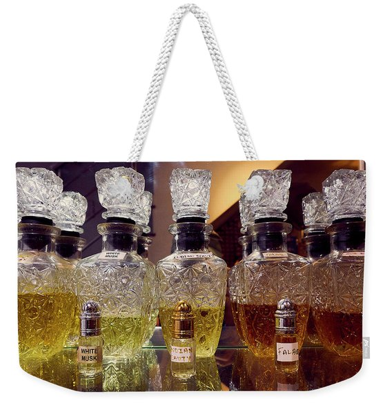 Weekender Tote Bag featuring the photograph Musk by Whitney Goodey