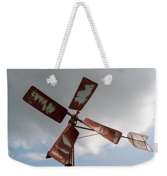 Weekender Tote Bag featuring the photograph Old Rusty Windmill. by Anjo Ten Kate