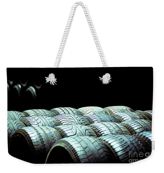 Old Tires And Racing Wheels Stacked In The Sun Weekender Tote Bag