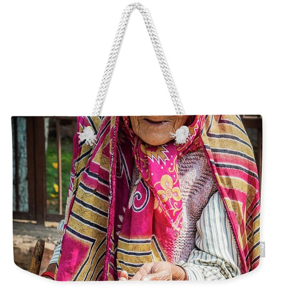 Weekender Tote Bag featuring the photograph Old Woman by Robin Zygelman