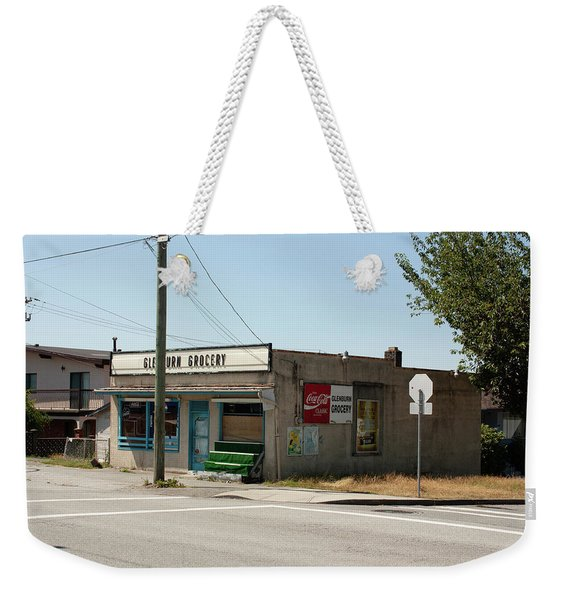 Weekender Tote Bag featuring the photograph On Gilmore by Juan Contreras