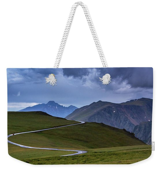 Weekender Tote Bag featuring the photograph On Top Of The World by John De Bord