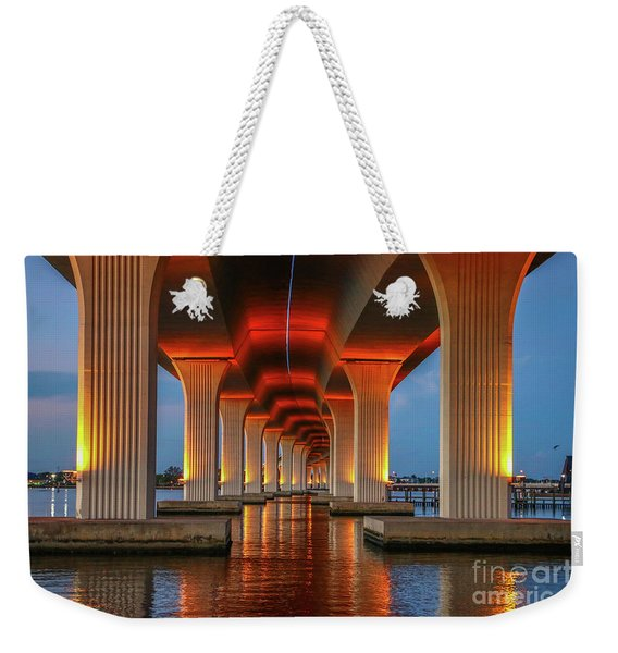 Weekender Tote Bag featuring the photograph Orange Light Bridge Reflection by Tom Claud