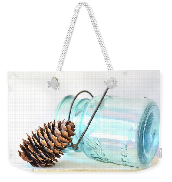Weekender Tote Bag featuring the photograph Pine Cone And A Jar by Michelle Wermuth