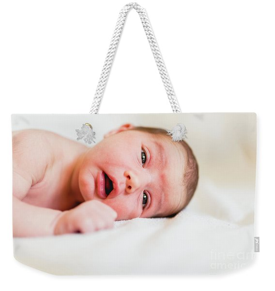 Portrait Of Newborn Baby Girl Feels Safe And Awake To A New Life. Weekender Tote Bag