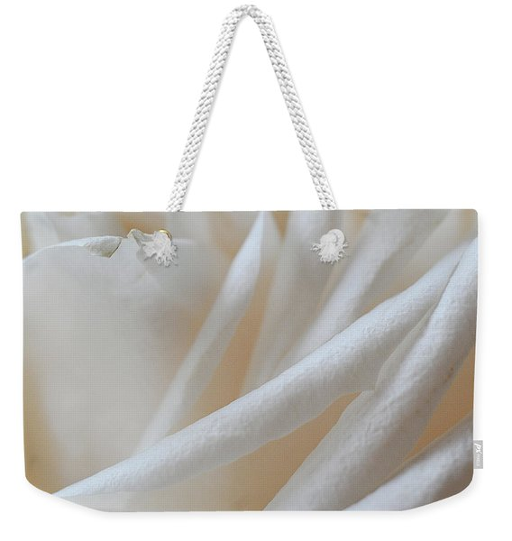 Weekender Tote Bag featuring the photograph Purity by Michelle Wermuth