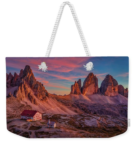 Weekender Tote Bag featuring the photograph Red Evening On Tre Cime Di Lavaredo by Dmytro Korol