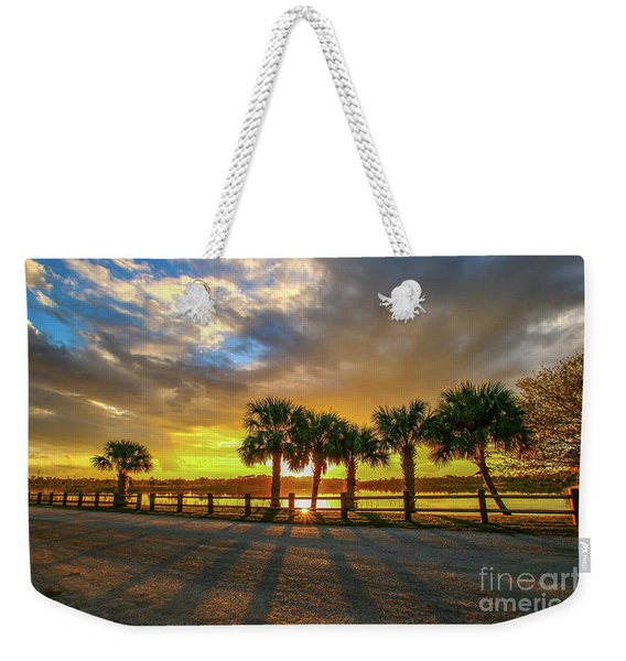 Weekender Tote Bag featuring the photograph Reflected Sunburst by Tom Claud