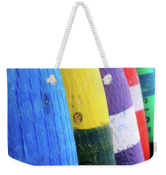 Weekender Tote Bag featuring the photograph Row Of Buoy by JAMART Photography