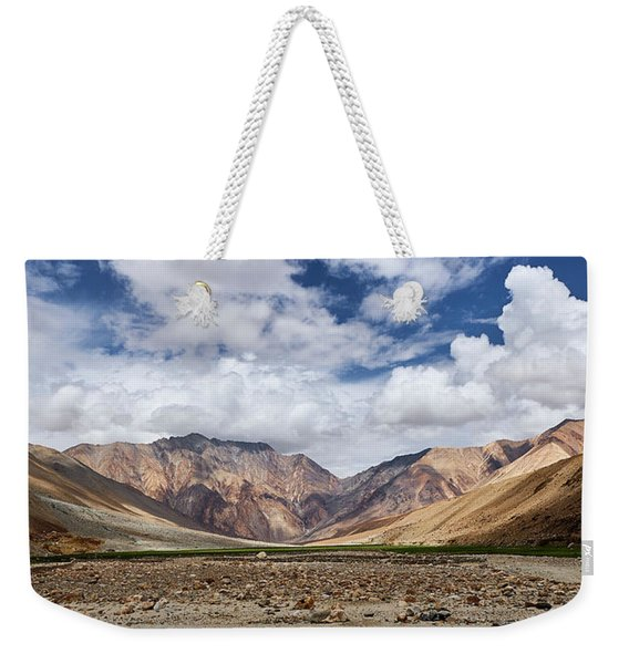 Weekender Tote Bag featuring the photograph Rugged Himalayan Mountains by Whitney Goodey