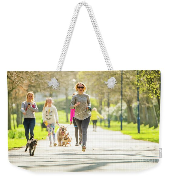 Running With Her Dog In The Park Weekender Tote Bag