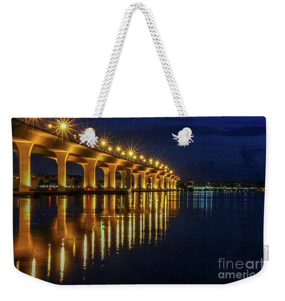 Weekender Tote Bag featuring the photograph Starburst Bridge Reflection by Tom Claud