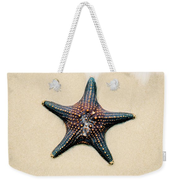 Starfish On The Beach Sand. Close Up. Weekender Tote Bag
