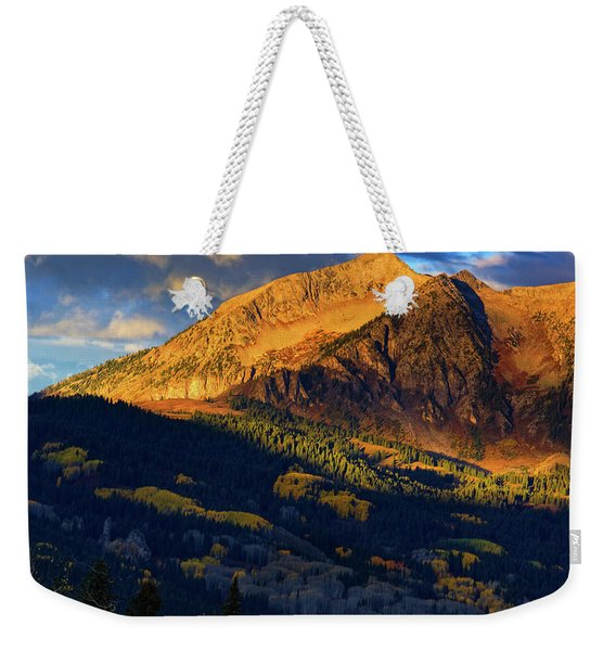 Weekender Tote Bag featuring the photograph Sunlight Along The Mountain by John De Bord