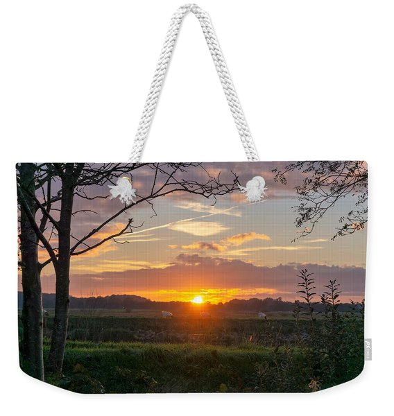 Weekender Tote Bag featuring the photograph Sunset by Anjo Ten Kate