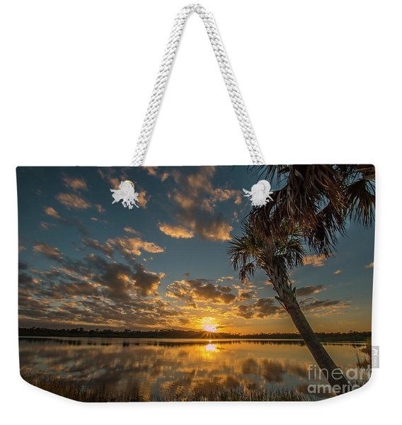 Weekender Tote Bag featuring the photograph Sunset On The Pond by Tom Claud