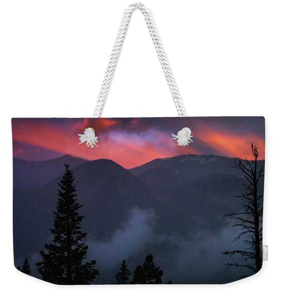 Weekender Tote Bag featuring the photograph Sunset Storms Over The Rockies by John De Bord