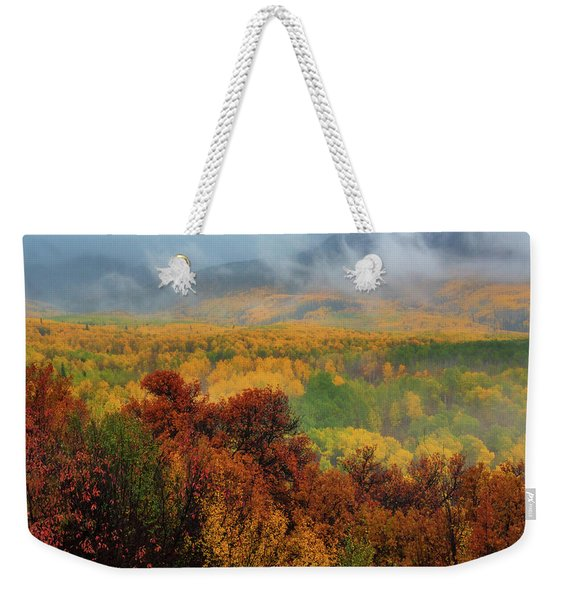 Weekender Tote Bag featuring the photograph The Feeling Of Fall by John De Bord