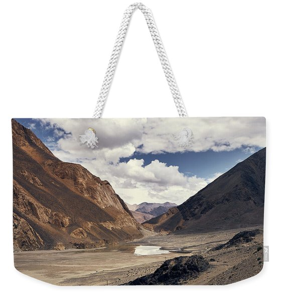 Weekender Tote Bag featuring the photograph The Long Journey by Whitney Goodey